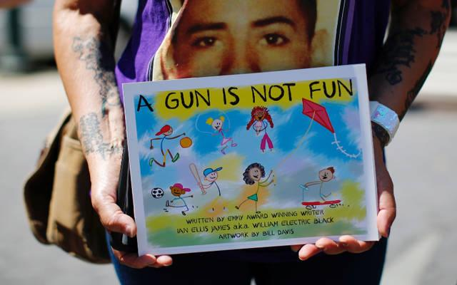 <p> A woman protests Aug. 12 regarding the flow of illegal guns in New York City. (CNS photo by Eduardo Munoz/Reuters) </p>