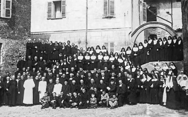 <p>Priests and religious gather for a photo during a reunion in the northern Italian village of Lu in 1946, more 60 years after their mothers began praying for vocations to come from their own families.  Photo courtesy of the Mothers of Lu </p>
