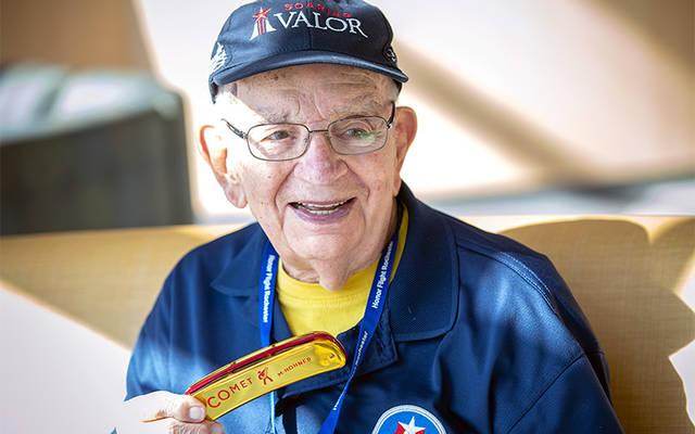 <p>&rdquo;Harmonica Pete&rdquo; DuPr&#233; performed for fellow World War II veterans at the Rochester International Airport as they prepared to depart on a trip to the National World War II Museum in New Orleans Oct. 9. (Courier photo by Jeff Witherow)  </p>