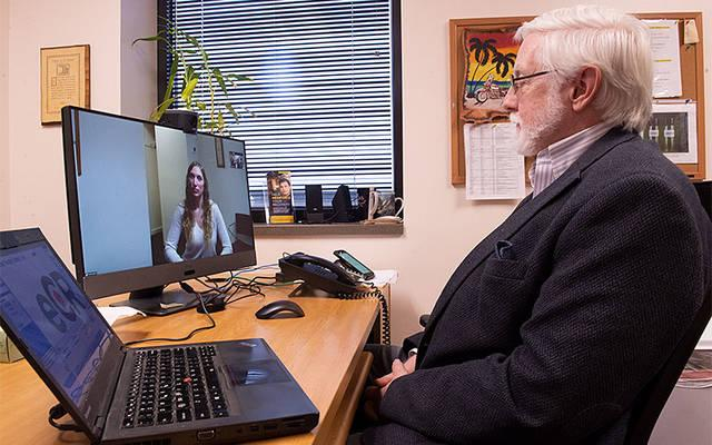 <p>Dr. Robert Young and Jessica Pruitt demonstrate Catholic Family Center&rsquo;s new telehealth capabilities in Rochester Oct. 16. (Courier photo by John Haeger)  </p>