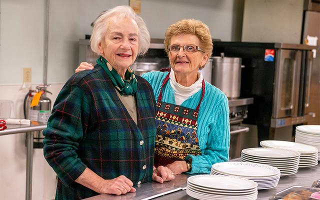 <p>Elmira Community Kitchen director Kathy Dubel (left) and volunteer Mary Kay Brown pose for a photo at the kitchen Nov. 8. (Courier photo by Jeff Witherow)  </p>