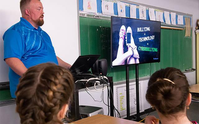 <p>Eric Bielski, information security manager for Rochester Regional Health Information Organization, talks with St. Francis-St. Stephen School students about cyberbullying and online safety during at the Geneva school Oct. 18. (Courier photo by John Haeger)  </p>