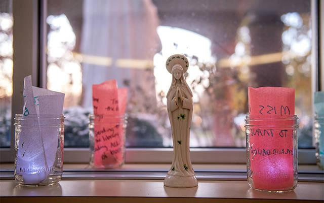<p>Lighted memory jars created by St. Ann&rsquo;s Community residents are displayed in the community&rsquo;s lobby Nov. 7. (Courier photo by Jeff Witherow)  </p>