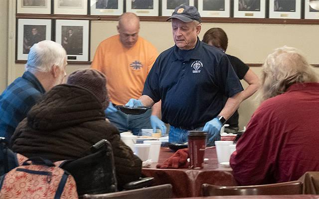 <p>Grand Knight Jack Baraczek serves soup to guests of the Winter Soup Kitchen Feb. 18 at the headquarters of Knights of Columbus Council No. 207 in Auburn. (Courier photo by John Haeger)  </p>