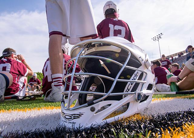 A lacrosse helmet sits on the field during the Section 5 championship at St. John Fisher College in Pittsford June 1. Lacrosseis one of several high-school sports whose players report the most concussions.