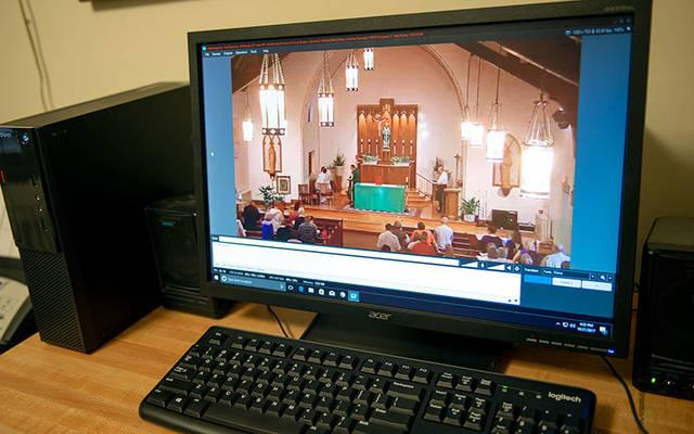 <p>A Mass is streamed over YouTube Oct. 21, 2017, at St. Patrick Church in Victor. (File photo)  </p>