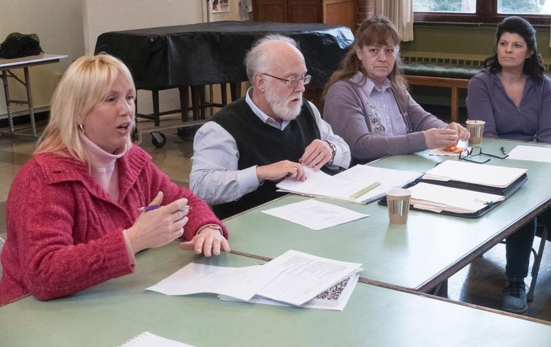 During a March 13 meeting at The Presbyterian Church in Geneva, Kathleen Wagner (left) gives an overview of Family Promise of Ontario County as Bill Fox, Judy Andrews and Karen Andrews look on. The program assists families in the county who are homeless.