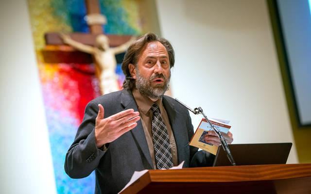 <p>Peter Colosi gives a presentation on the euthanasia debate Aug. 3 at St. John of Rochester Church in Fairport. Colosi is an assistant professor of philosophy at Salve Regina University in Newport, R.I.  Courier photos by Jeff Witherow </p>