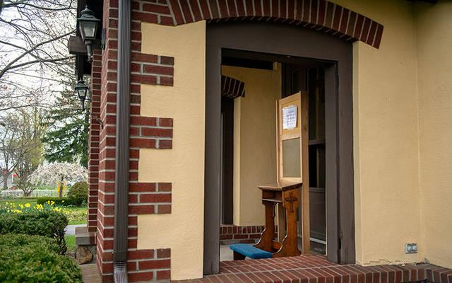 <p> To encourage social distancing, Father Peter Matola has set up a temporary confessional outside of the rectory at St. John the Evangelist Church in Spencerport.</p>
