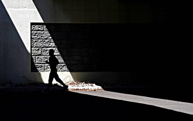 <p>A man jogs April 15 in Alexandria, Va. (CNS photo by <strong>Kevin Lamarque/Reuters</strong>)  </p>