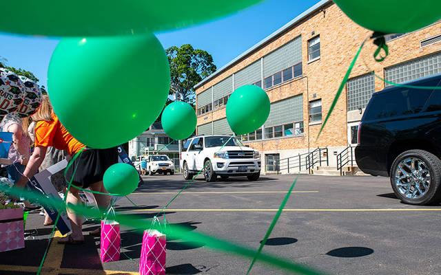 <p>Cars pass by Auburn&rsquo;s St. Joseph School June 17 during a goodbye parade. (Courier photo by Jeff Witherow)  </p>