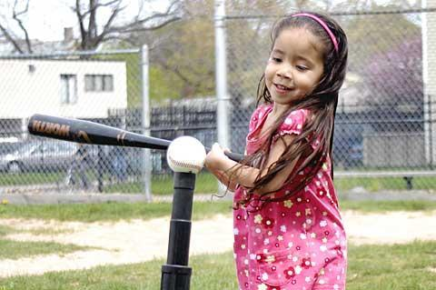 Four-year-old Julianna Gonzalez takes a swing at Don Samuel Torres Park April 24 during Healthy Kids Day, an event promoting a healthy weight program offered by Ibero-American Action League's Promotores de Salud.