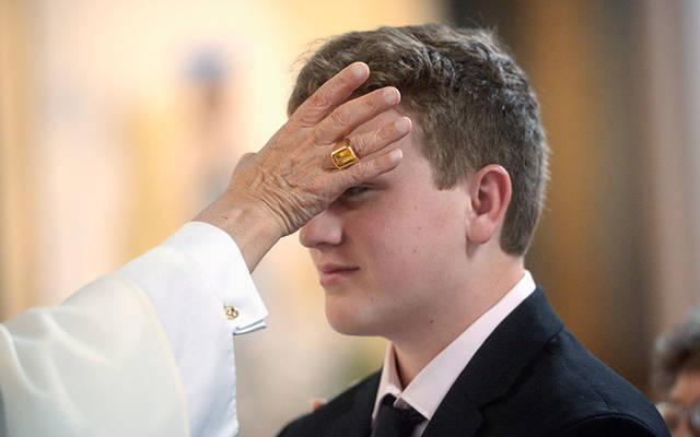 <p>In May 2019, Bishop Salvatore R. Matano anoints a confirmand&rsquo;s forehead during the celebration of the sacrament at Immaculate Conception Church in Ithaca. (Courier file photo)  </p>