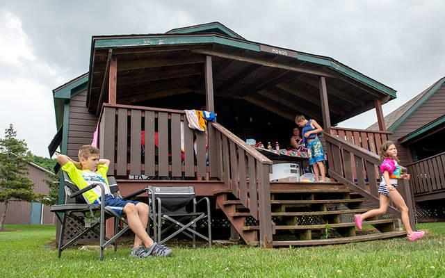 <p>Mitchell Walluk (from left) Sharon Hodge, Brayden Hodge and Claire Hodge share a cabin at Camp Stella Maris with other members of their family July 23. (Courier photo by Jeff Witherow)  </p>