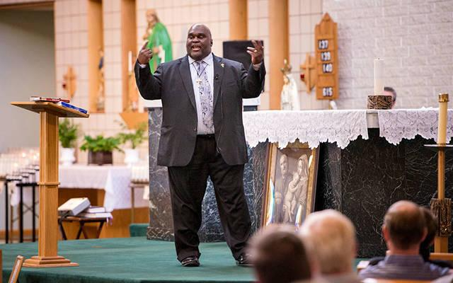 <p>Deacon Harold Burke-Sivers speaks during the 2016 Rochester Catholic Men&rsquo;s Conference at St. Jude the Apostle Church in Gates. (File photo)  </p>