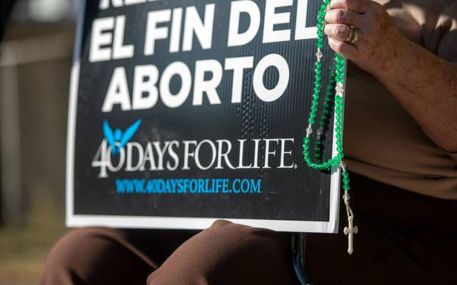 <p> Sharon Prince protests outside Planned Parenthood in Rochester Sept. 23 on the first day of the 40 Days for Life fall campaign. </p>