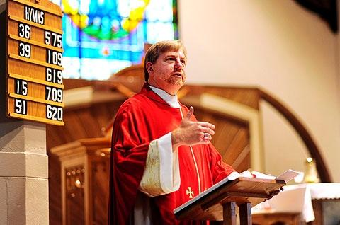 Father Scott Caton, pictured here celebrating Mass at Brockport's Nativity of the Blessed Virgin Mary Church, will help lead a conference discussing issues of the Catholic faith.