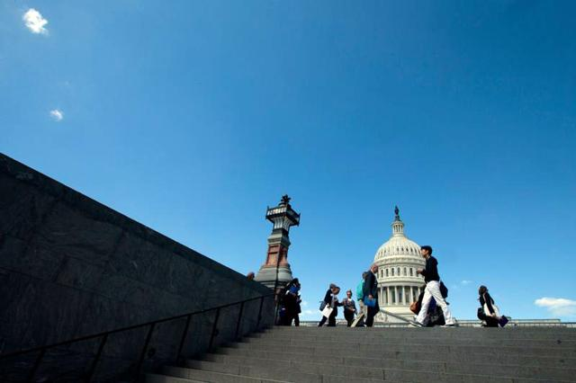 People walk near the U.S. Capitol in Washington May 3. President Donald Trump's proposed fiscal year 2018 budget has prompted church leaders and advocates to question the administration's commitment to people in need because of its deep cuts in social services.
