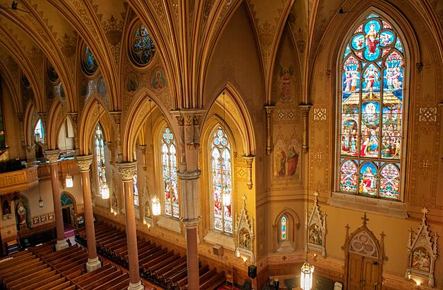A crew recently used drones and a hydraulic lift to photograph hard-to-reach places inside and outside Rochester's St. Michael Church. This photo was taken of the south facing stained-glass windows from a lift high above the floor March 11.