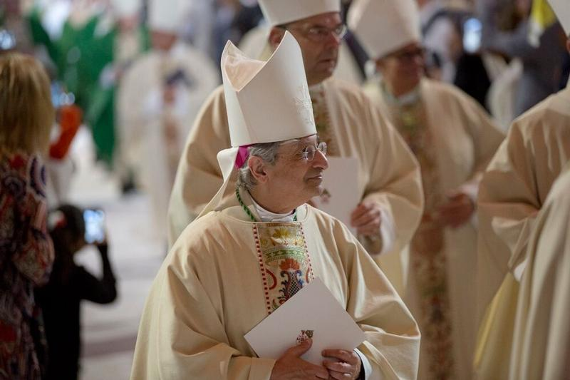 Bishop Salvatore R. Matano processes out of Madison Square Garden in New York after a Mass celebrated by the pope Sept. 25.
