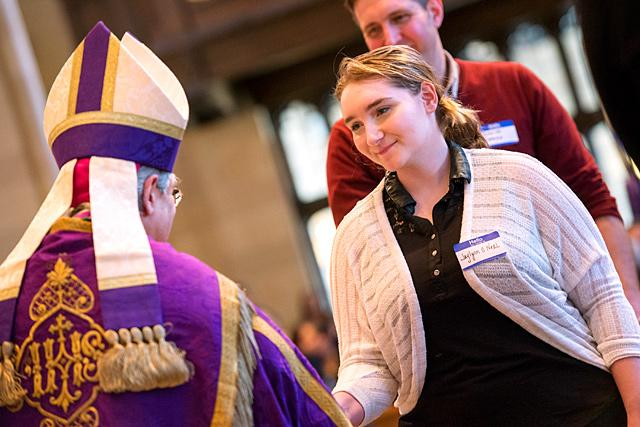 Catechumen Jaylynn O'Neal is greeted by Bishop Salvatore R. Matano after signing the Book of the Elect during the Rite of Election and Call to Continuing Conversion at Rochester's Sacred Heart Cathedral March 5.