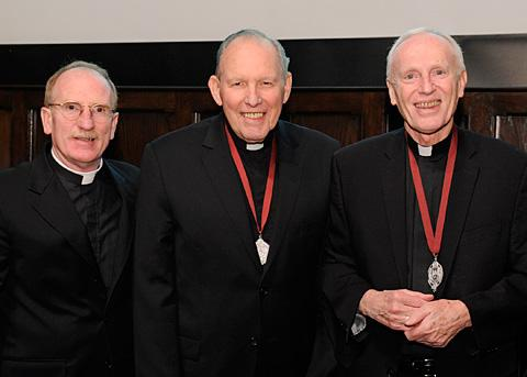 Joseph M. McShane, S.J. (from left), president of Fordham University, Bishop Emeritus Matthew H. Clark and Albany Bishop Howard J. Hubbard pose together after the bishops were presented with the Fordham President's Medal March 6.