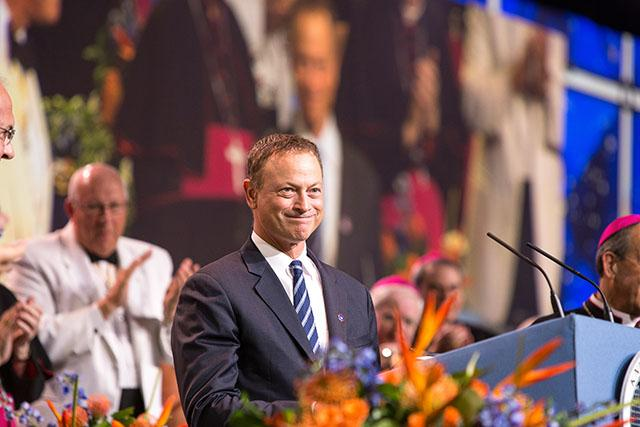 "Actor Gary Sinise smiles as he speaks Aug. 5 at the 132nd Supreme Convention of the Knights of Columbus held in Orlando, Fla. Sinise, who is perhaps best known for his role as Lt. Dan in the 1994 film ""Forrest Gump,"" spoke about his support for disabled veterans and his own journey to the Catholic faith."