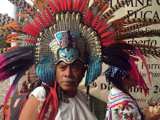 """Jose Alfredo Robles, a """"conchero"""" dancer, attends the Dec. 9 feast day for St. Juan Diego at the Basilica of Our Lady of Guadalupe in Mexico City. The indigenous saint has not attracted a large devotion since being canonized in 2002."""