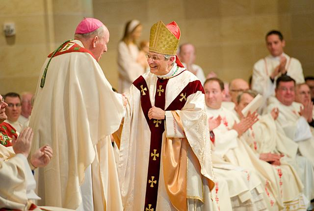 Bishop Salvatore R. Matano (right) thanks Bishop Emeritus Matthew H. Clark for his many years of service to the Diocese of Rochester during Bishop Matano's Jan. 3 installation Mass at Rochester's Sacred Heart Cathedral.