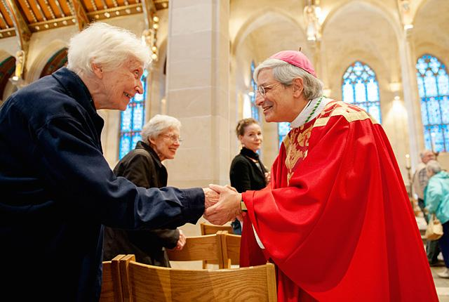 Bishop Salvatore R. Matano greets Cathedral Community parishioner Faith Connors after celebrating Mass at Sacred Heart Cathedral Nov. 6.