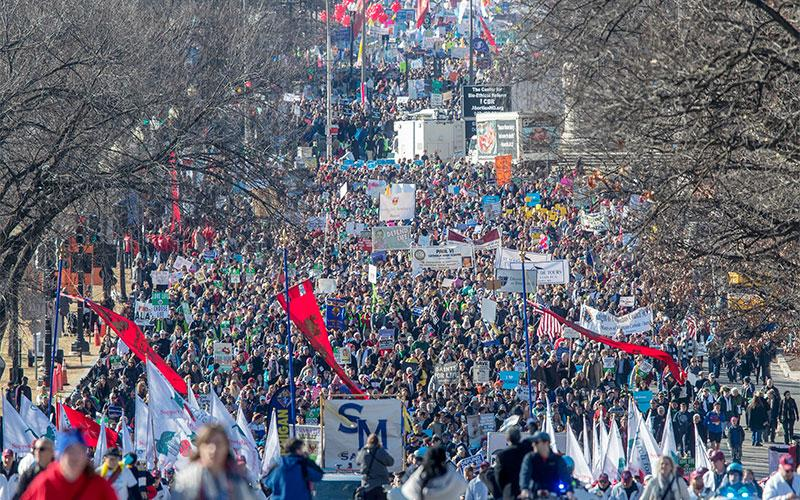 """People walk up Constitution Avenue headed toward the U.S. Supreme Court while participating in the 45th March for Life Jan. 19 in Washington. The 2019 March for Life is Jan. 18 and the theme will be """"Unique from Day One."""""""