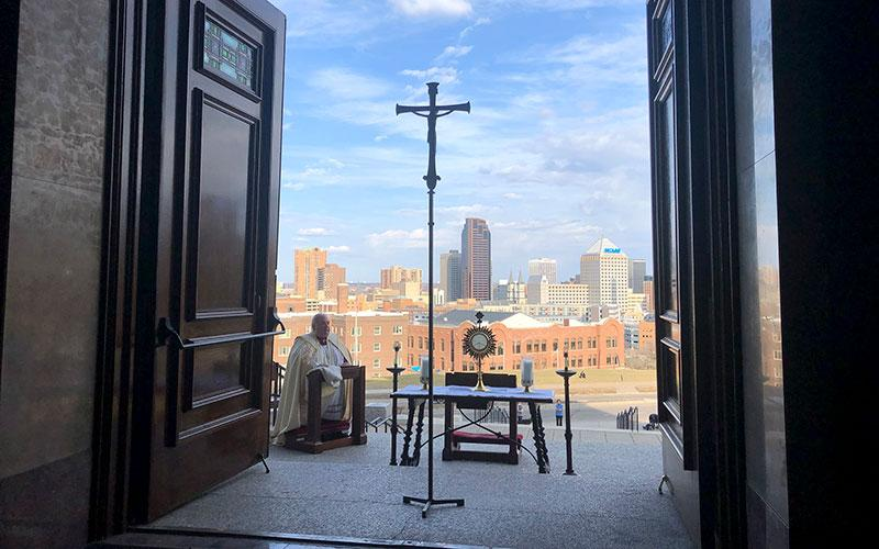 Archbishop Bernard A. Hebda of St. Paul and Minneapolis prays in front of the Blessed Sacrament at the Cathedral of St. Paul in St. Paul March 27, 2020.