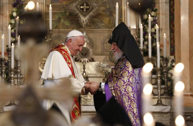 Pope Francis exchanges greetings with Catholicos Karekin II, patriarch of the Armenian Apostolic Church, as they visit the Armenian Apostolic Cathedral at Etchmiadzin in Vagharshapat, Armenia, June 24.