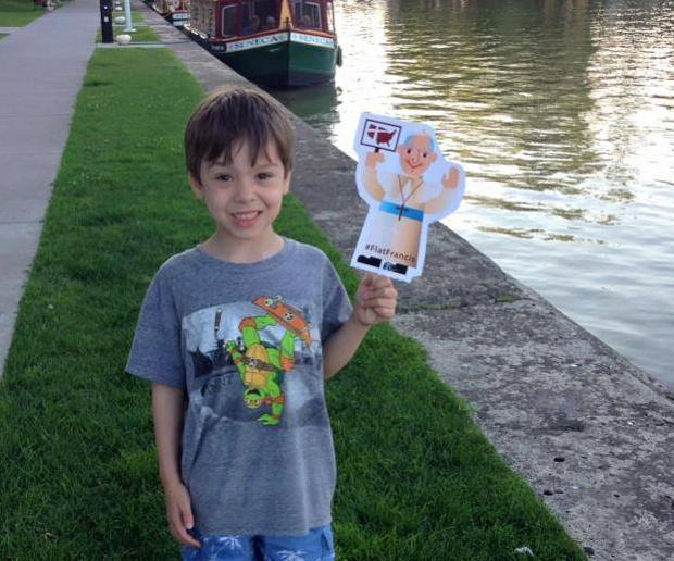 Five-year-old Ryker Christensen, of Blessed Sacrament Church, Rochester, with #FlatFrancis along the Erie Canal in Pittsford. Ryker won first place in our #FlatFrancis contest.