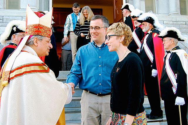 Bishop Matano greets parishioners outside the Assumption of the Blessed Virgin Mary Church in Middlebury, Vt., in May 2012. (Photo courtesy of the Vermont Catholic)