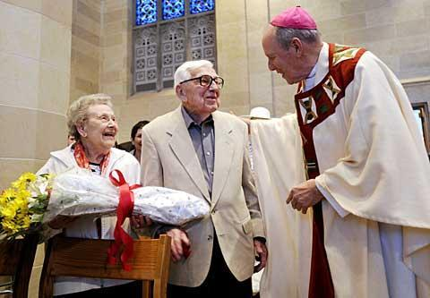 Michael and Virginia Yanko, who will celebrate their 75th wedding anniversary on Sept. 12, are congratulated by Bishop Matthew H. Clark during the Wedding Jubilee Mass at Sacred Heart Cathedral May 16.