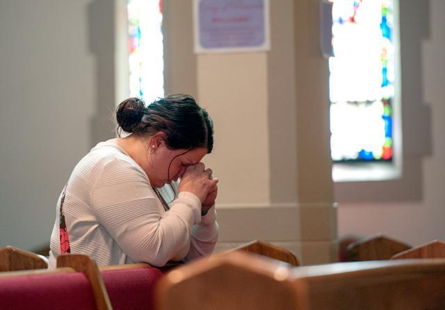 Carrie Guererro prays at Brockport's Nativity of the Blessed Virgin Mary Church after making confession on the Day of Penance and Mercy in 2014. (File photo)