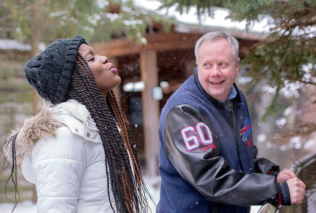 Shana Campbell, 17, exhales to see her breath during a visit to Rochester's Seneca Park Zoo with Deacon Kevin Carges Jan. 4. Deacon Carges is raising money for a surgery Shana needs due to wounds she suffered in a machete attack in her native Jamaica.