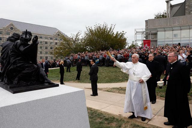 "Pope Francis blesses a sculpture during a brief stop at St. Joseph's University in Philadelphia Sept. 27. The sculpture commemorates the 50th anniversary of ""Nostra Aetate,"" the Second Vatican Council Declaration on the Relationship of the Church to Non-Christian Religions."