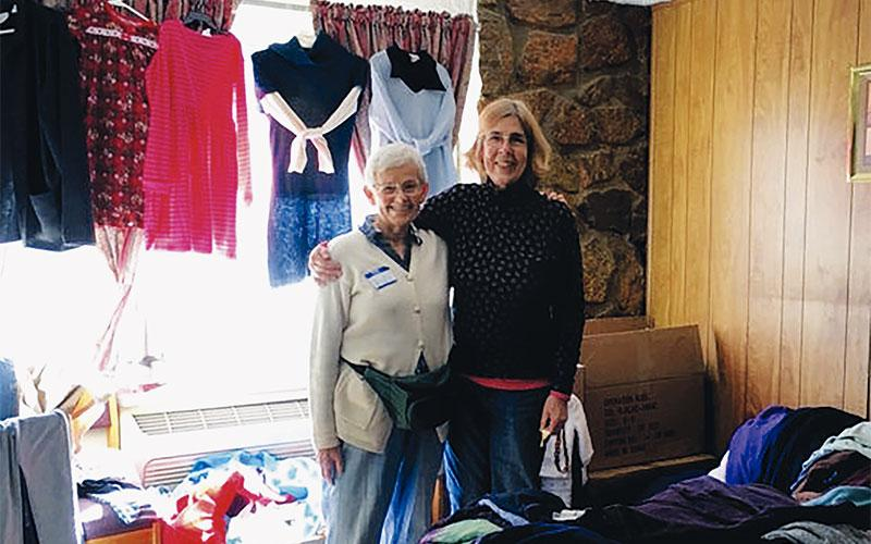 Local volunteers Anne Meyer-Wilber and Sister Phyllis Tierney, SSJ, worked together to organize a room a room full of donated clothing for immigrants staying at a shelter located inside La Mesa Inn in El Paso, Texas.  (Photo courtesy of Anne Meyer-Wilber)