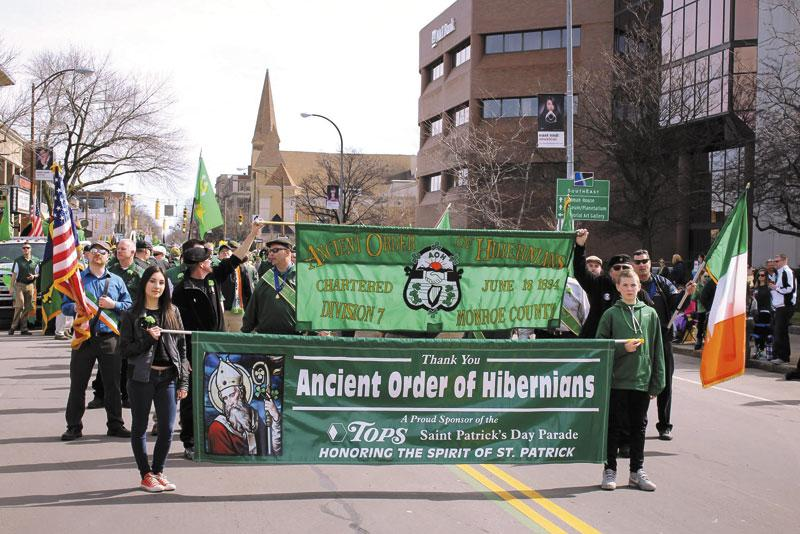 Members of the Ancient Order of Hibernians march in Rochester's 2016 St. Patrick's Day Parade.