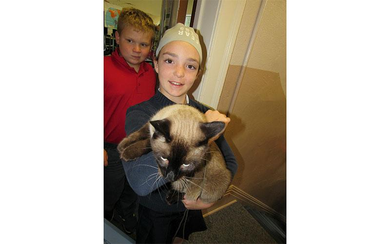 Vivianne Boor with her cat head out for the Annual Pet Blessing.
