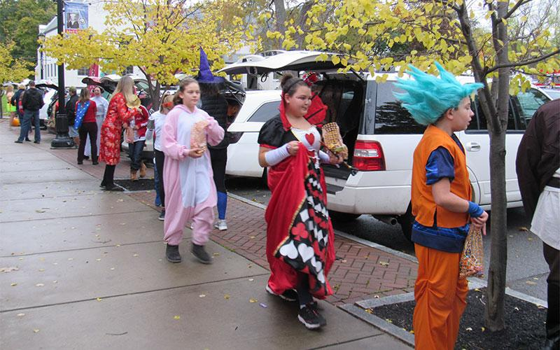 Reilly Calnan, Marli Dambra and Elizabeth Caiazzo trick or treat at St. Agnes School's Trick or Trunk event.