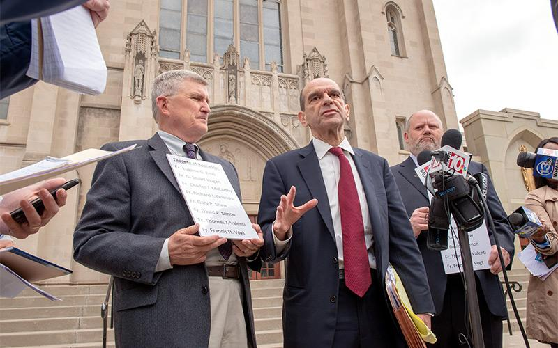 Attorney Mitchell Garabedian (center) addresses reporters during a press conference in front of Sacred Heart Cathedral June 6.(Courier photo by Jeff Witherow)