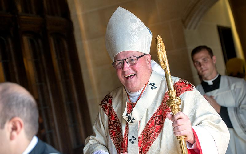 Cardinal Timothy Dolan processes into Rochester's Sacred Heart Cathedral before celebrating a Sept. 22 Mass in recognition of the Diocese of Rochester's 150th anniversary.