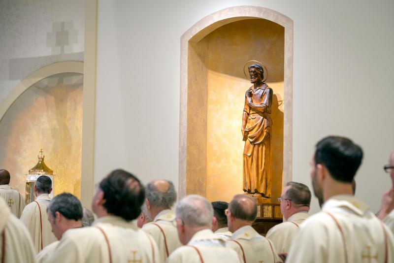 A recovered statue of St. Joseph from the 2015 fire is positioned to the right of the altar. (Courier photo by Jeff Witherow)