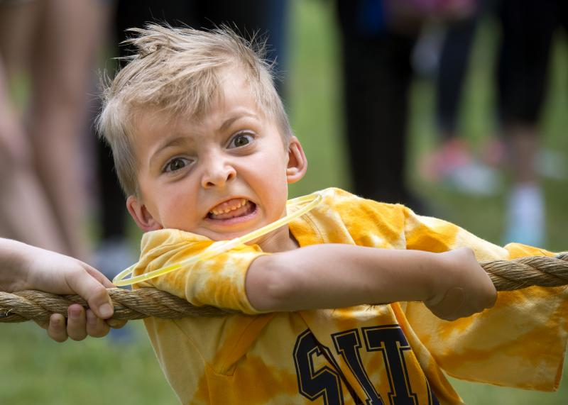 First-grader Liam Williams participates in a tug of war during the Blue-Gold Day at Webster's St. Rita School June 21. The field day event marked the last day of school for the students.