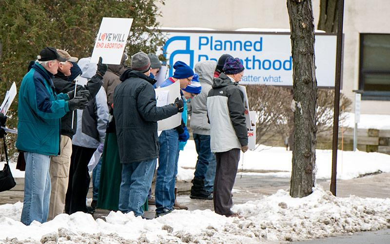 Pro-lifers rally outside of a Planned Parenthood location in Rochester during a Dec. 16 Stand Out for Life rally against abortion.