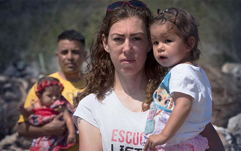 "In a two-hour special presentation with INDEPENDENT LENS, ""Marcos Doesn't Live Here Anymore"" tells a love story against the backdrop of the national immigration debate. This photograph is of Elizabeth standing with Georgia, and Marcos with Nelly. (Photo courtesy of Kimmer Olesak/PBS)"