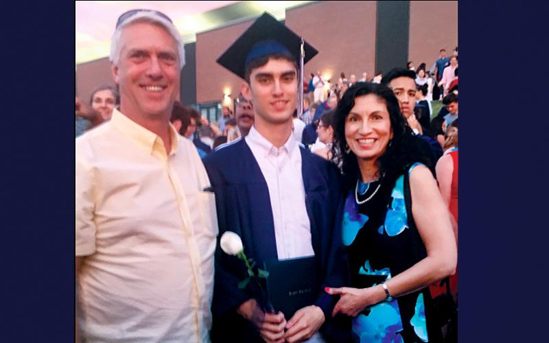 <p><i>Catholic Courier</i> Staff Writer Annette Jiménez (right) with her husband, Harry (left) and son, Aidan (center) at Aidan's high-school graduation June 19.